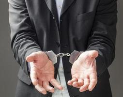 affärsman som går i fängelse foto