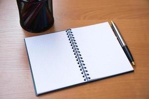 pappers anteckningsbok foto