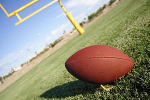 fotboll och fieldgoal foto