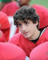 fotbollsspelare med lockigt hår foto