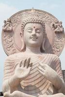 närbild av Buddhastatyn. foto
