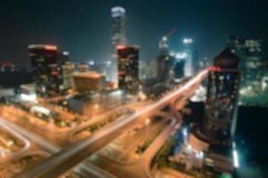 defocused urban skyline of Beijing Guomao, Kina foto