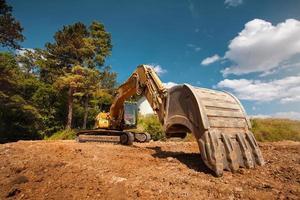 grävmaskin på byggarbetsplatsen foto