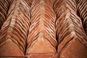 bruna takplattor för konstruktion foto