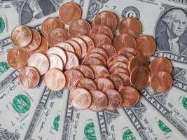 dollarmynt och sedlar foto