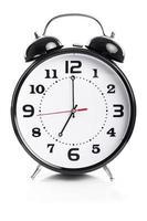 tid för arbete - väckarklocka visar sju klockor foto
