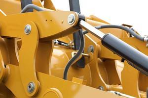 detalj av hydraulisk bulldozer vit bakgrund foto