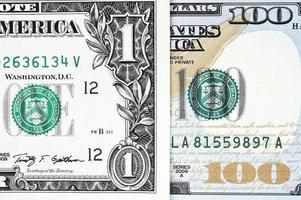 makro skott av en ny 100 dollar räkning och en dollar