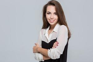 porträtt av en leende ung affärskvinna foto