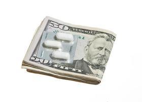 dollarn valuta och piller foto