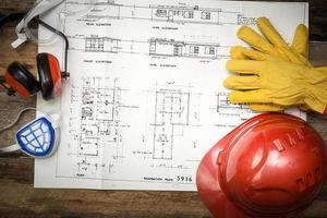 konstruktionsbakgrund med skyddande arbetskläder foto