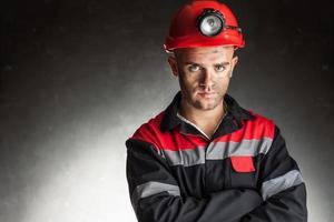 porträtt av allvarliga kol gruvarbetare foto