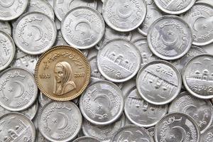 tio rupee-mynt av benazir bhutto foto