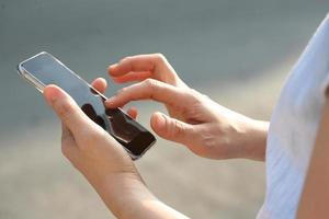pekskärm på smartphone foto