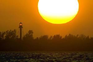 sanibel fyr vid solnedgången 1 foto