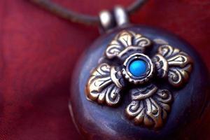 tibetansk amulett foto