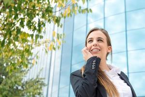 affärskvinna med mobil foto