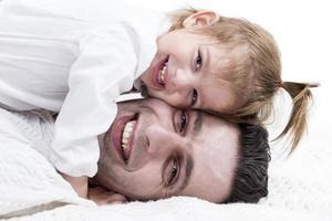 lycklig far och dotter foto