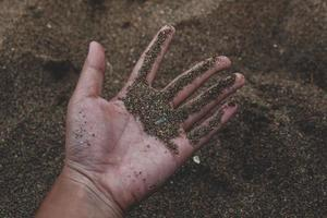 sand i handen foto