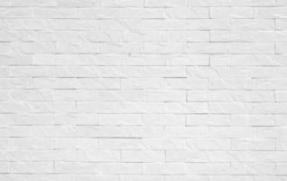 vit tegelvägg för bakgrund foto