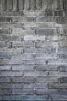 grå tegelvägg foto