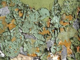 närbild av skalade målad vägg foto