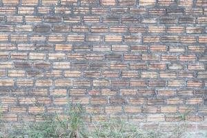 gammal tegelvägg för bakgrund eller struktur foto
