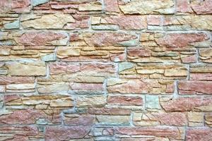 dekorativa färgglada nya naturliga stenmur foto