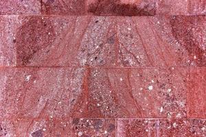 röd texturerad marmorbakgrund, dekorativa väggplattor foto