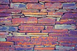 grunge vintage vägg av sten brickor foto