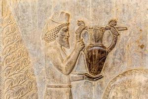 armeniska hyllning lättnad detalj persepolis foto