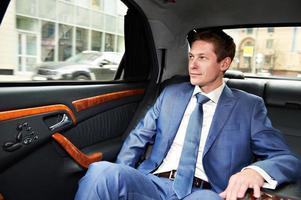 affärsman i bil foto