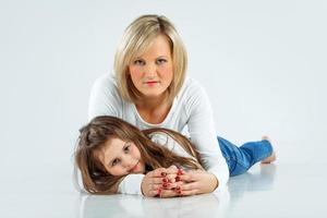 mamma med sin lilla flicka foto