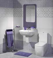 detalj i ett modernt badrum med handfat och toalett