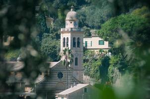 portklocka från portofino kyrka foto