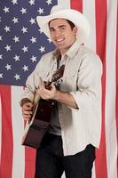 cowboy som spelar en gitarr foto