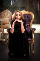 den svarta klänningen foto
