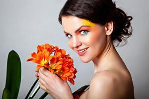 porträtt av en vacker leende flicka med fantasy-make-up foto