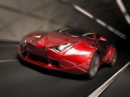 en röd sportbil som kör riktigt snabbt foto