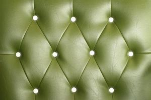 textur av vintage grön lädersoffa för bakgrund foto