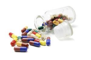 glasproppsburk med piller foto