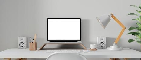 bärbar dator mockup i arbetsytan foto