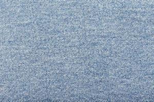 en närbild av ljusblått denimtyg foto