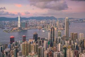 Victoria Harbour och Hong Kong solnedgång foto