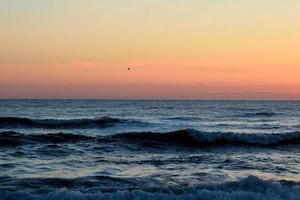 soluppgång vid havet foto