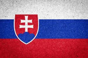 Slovakiens flagga på pappersbakgrund foto