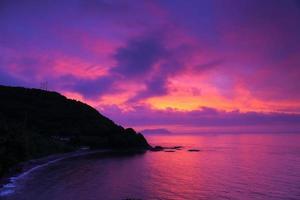 havet och soluppgången foto