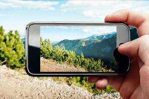 smart telefon mobilfoto på bergslandskap foto