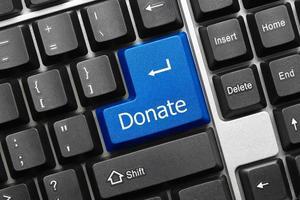 konceptuellt tangentbord - donera (blå nyckel)