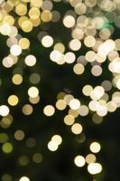 cirkulär bokeh bakgrund av julljus foto